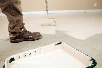 Painter painting garage floor in Cape Coral South